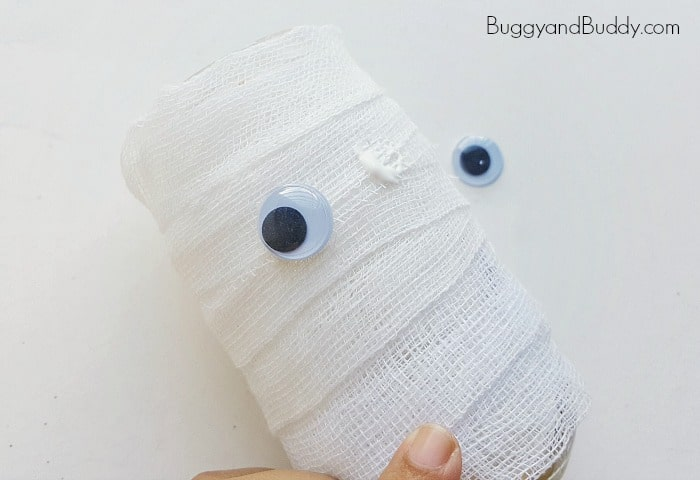 Glue googly eyes to your mummy craft