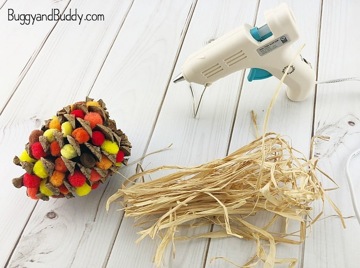cut raffia for the top of your pinecone indian corn craft